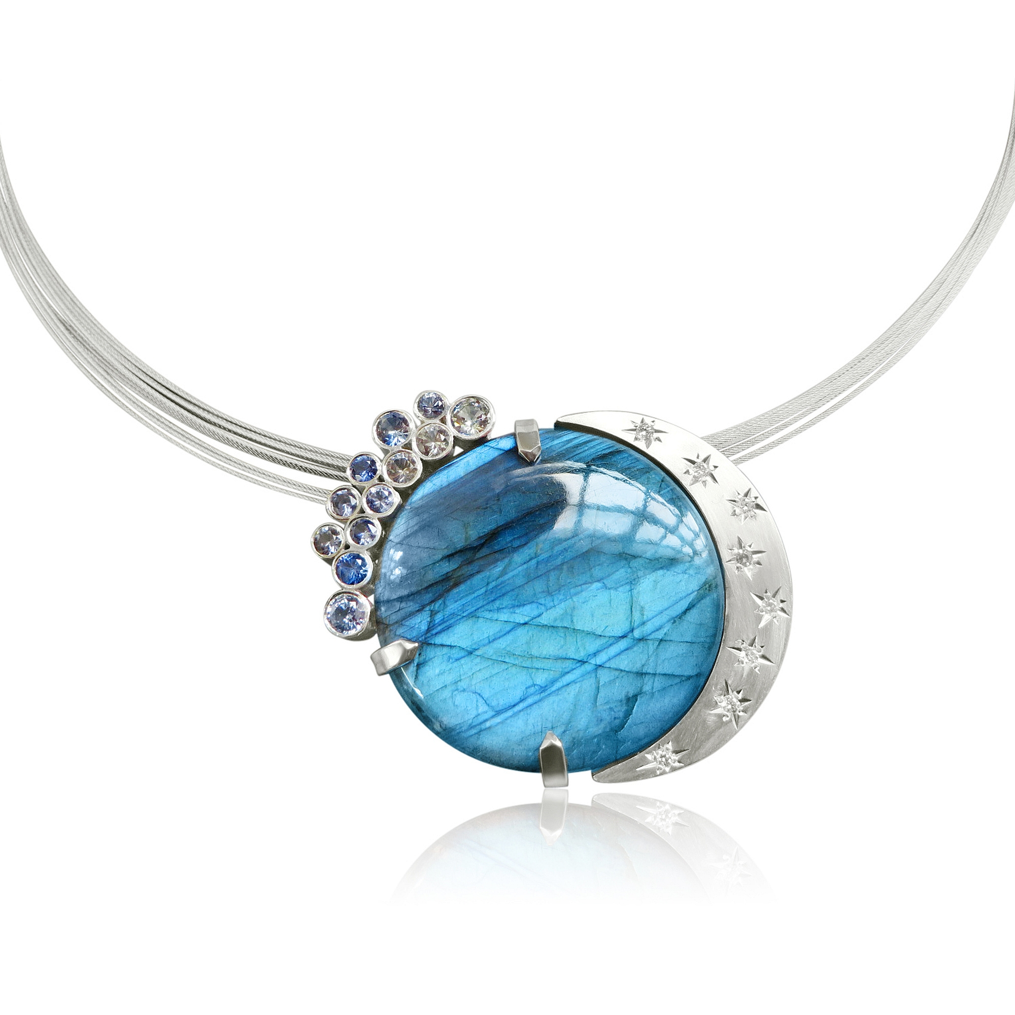 A brooch and pendant this stunning Labradorite circle of amazing colour is complimented by washed out blue Sapphires and Diamonds in stars, the reverse has a pierced out design to add to the theme solid silver with hand made fittings  SOLD
