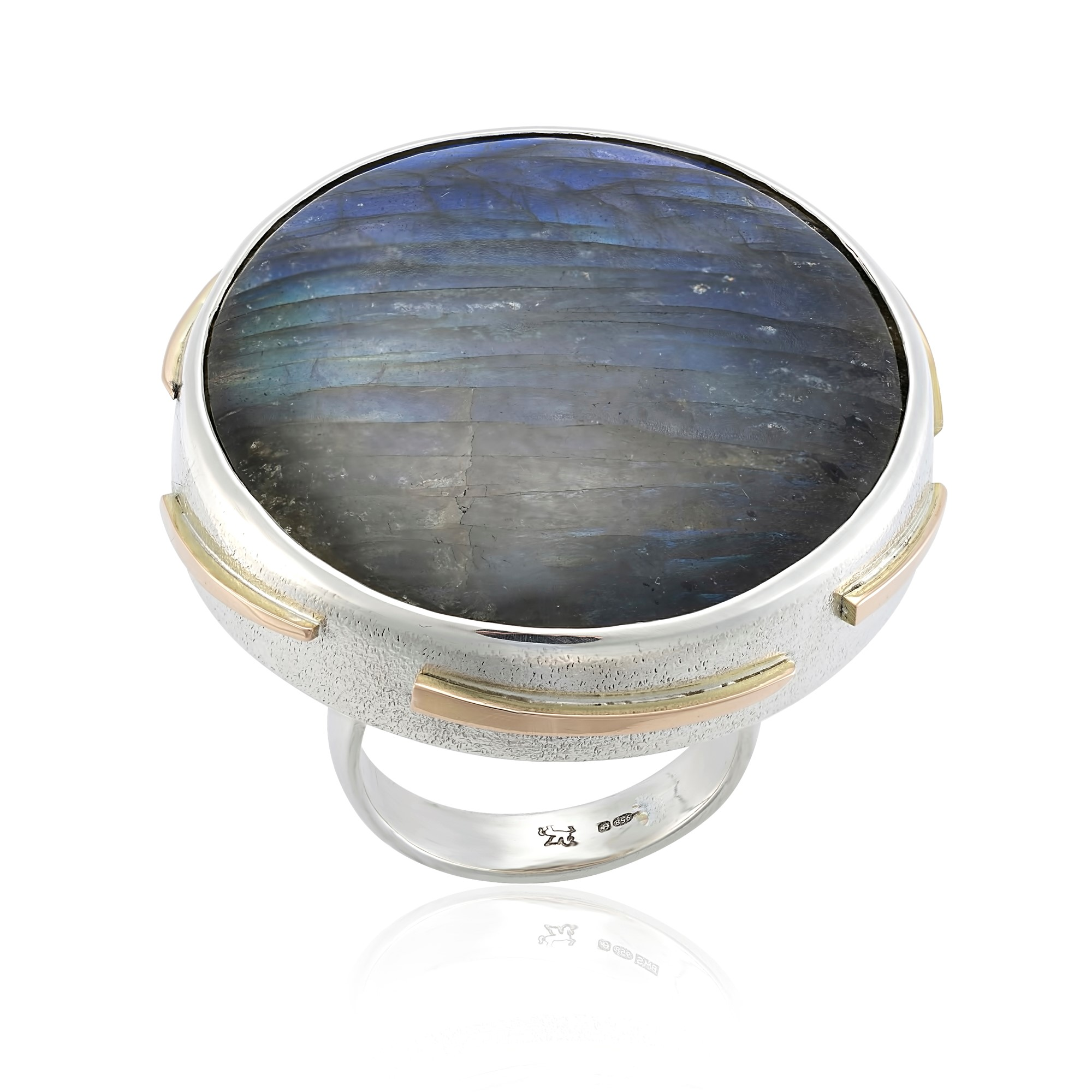 Labradorite in silver with gold detail this is a stunning blue sheen labradorite which has not been caught in the photo well however is stunning ,a big dress ring  AVAILABLE  ring size O