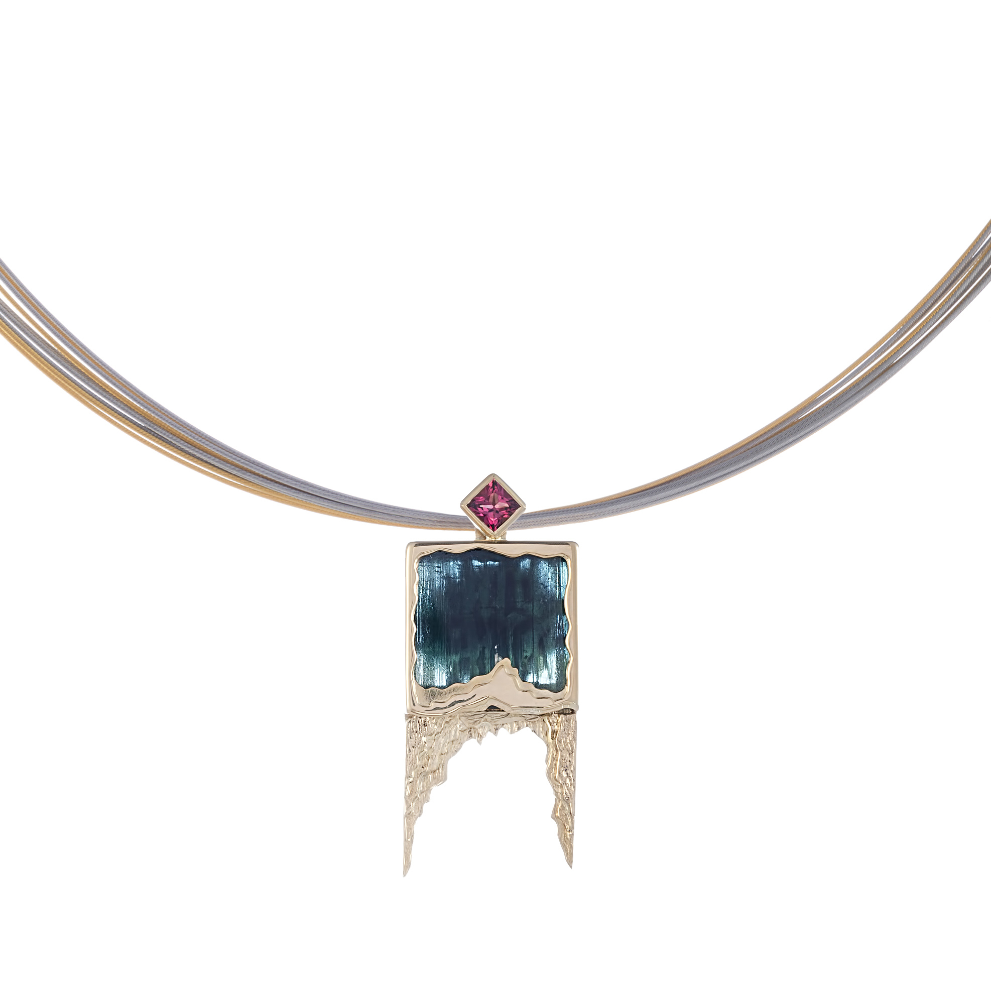 Indicolite Tourmaline polished one side and left raw on the back ,encased in an 18ct mount with a Rubalite Toumaline at the top  can be worn on chain or wire  sold separately  Available