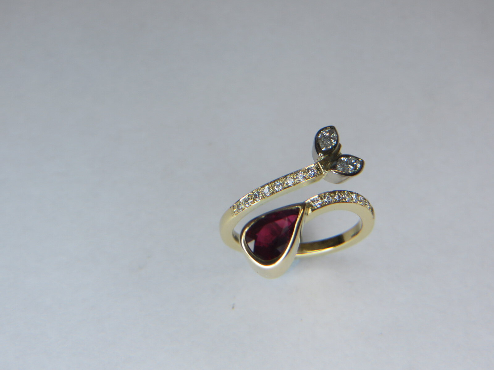 Ruby and Diamond dress ring mounted in 18ct Gold.