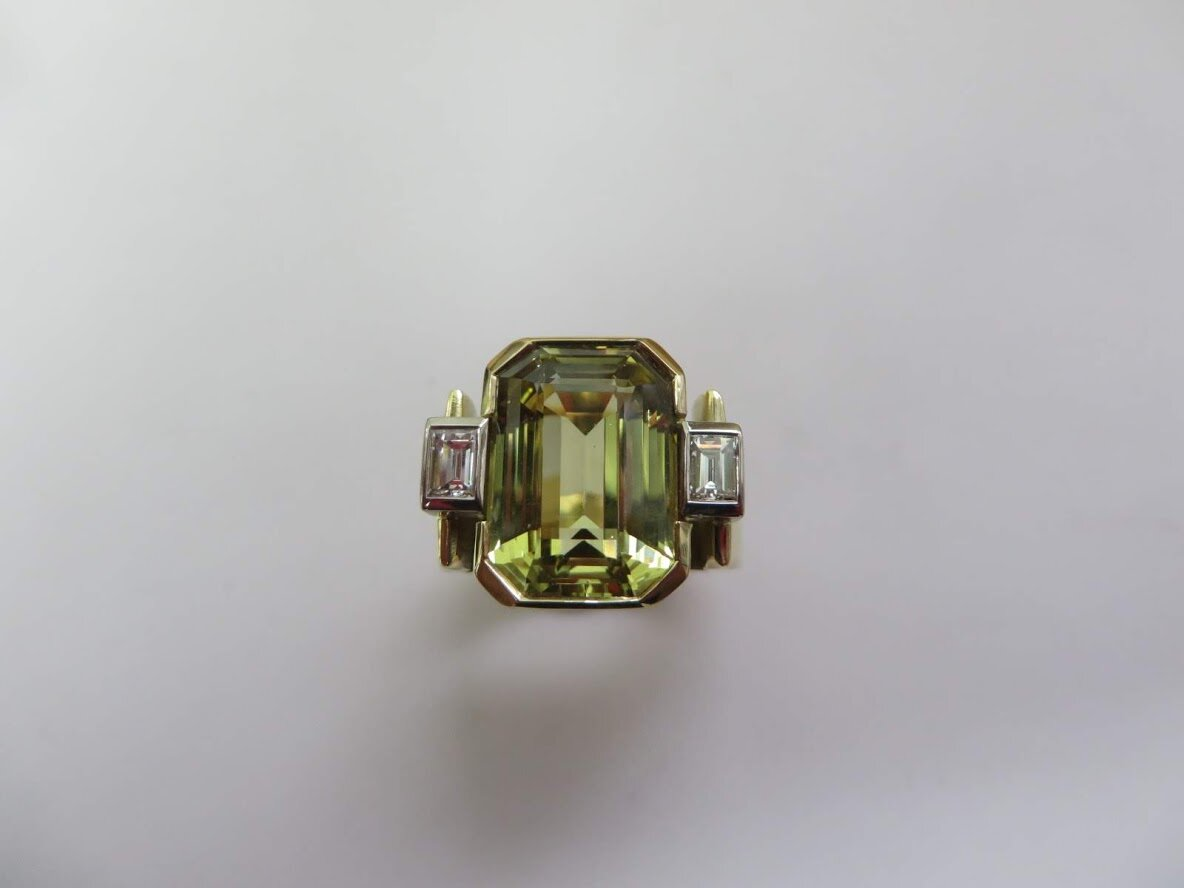11 carats of very rare Chrysoberyl Gemstone ,flanked by two Baguette Diamonds and mounted in 18ct Gold ,Designed and hand made by QV Jewellery.