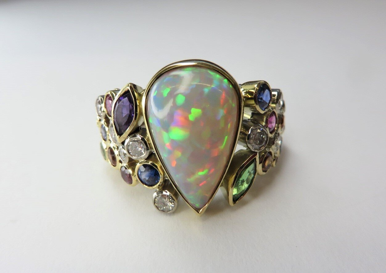 Beautiful Welo Opal Dress ring Commission ,surrounded by many coloured Gemstones ,from Diamonds to tsavorite garnet all hand made in 18ct gold by QV Jewellery.
