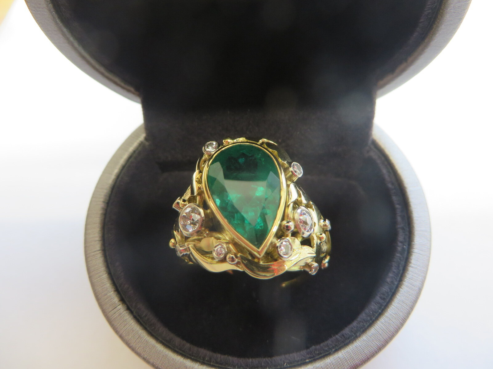 The finished ring ,which was quite spectacular due to the size of the center stone,a stunning Emerald surrounded by Diamonds also recovered from the clients old Jewellery.