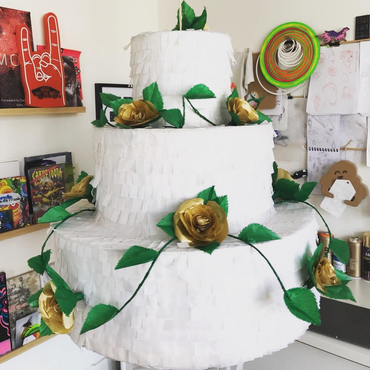 Three tiered wedding cake piñata.