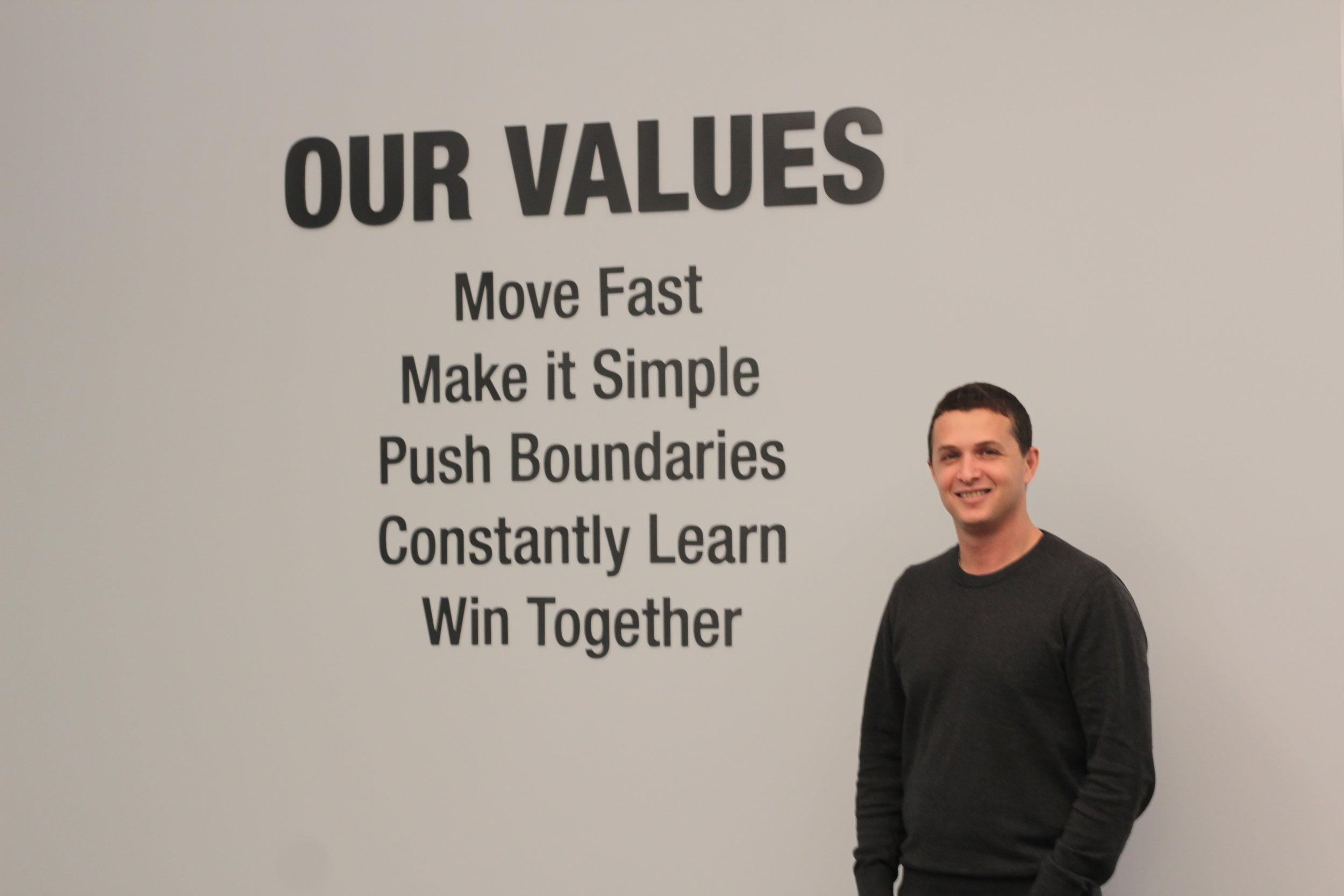 Eyal next to BlueVine's Company Values