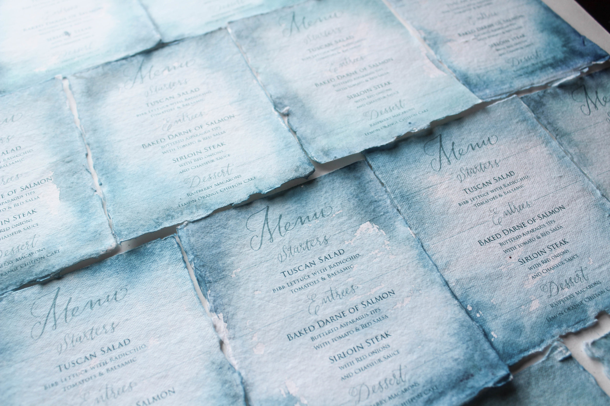 Teal wedding menus on handmade paper.