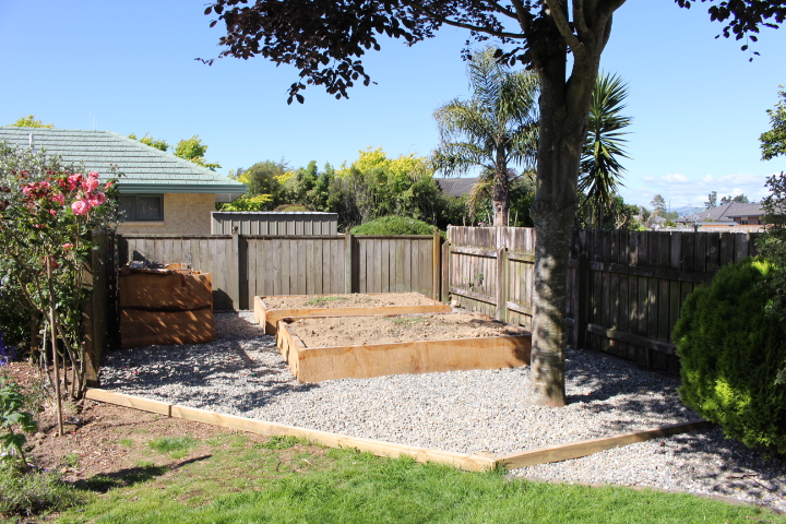 Garden clean up and construction of raised garden beds and compost bin using Cedar milled from a tree removed from the same site.