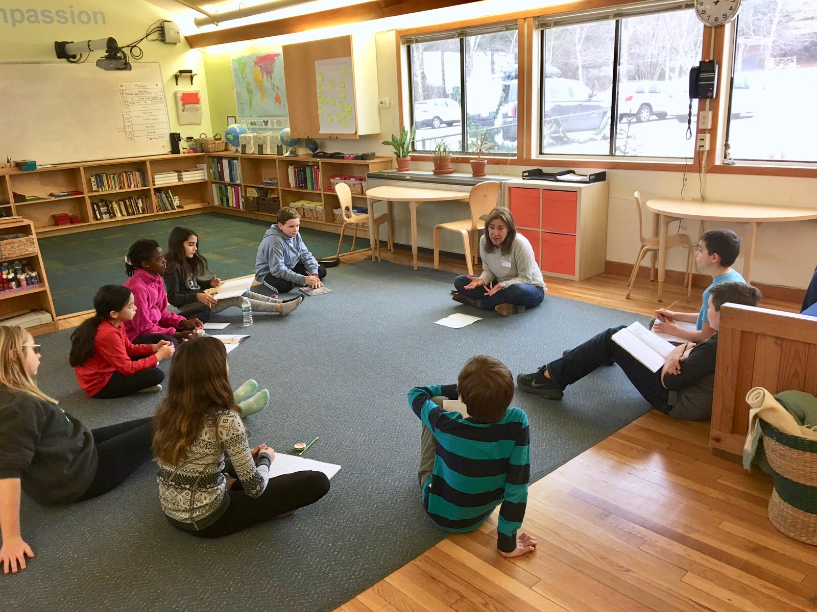 Board Member, Jill Cuomo, works with students at the Inly School as they learn more about our mission.