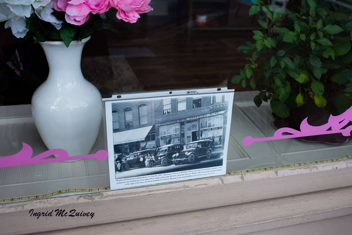 Look for historic photographs in the windows of local business in the town of Independence, Oregon.