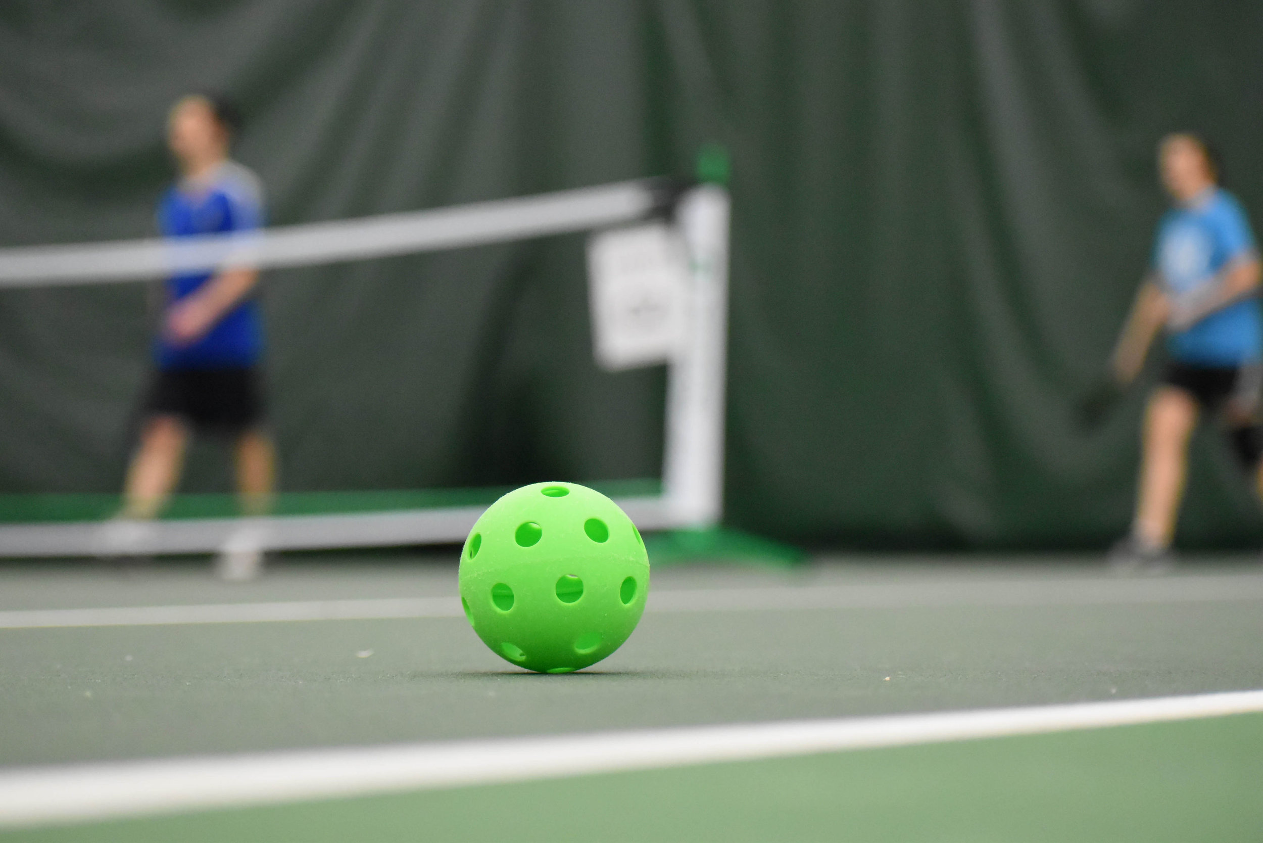 Green Pickleball on court.jpg