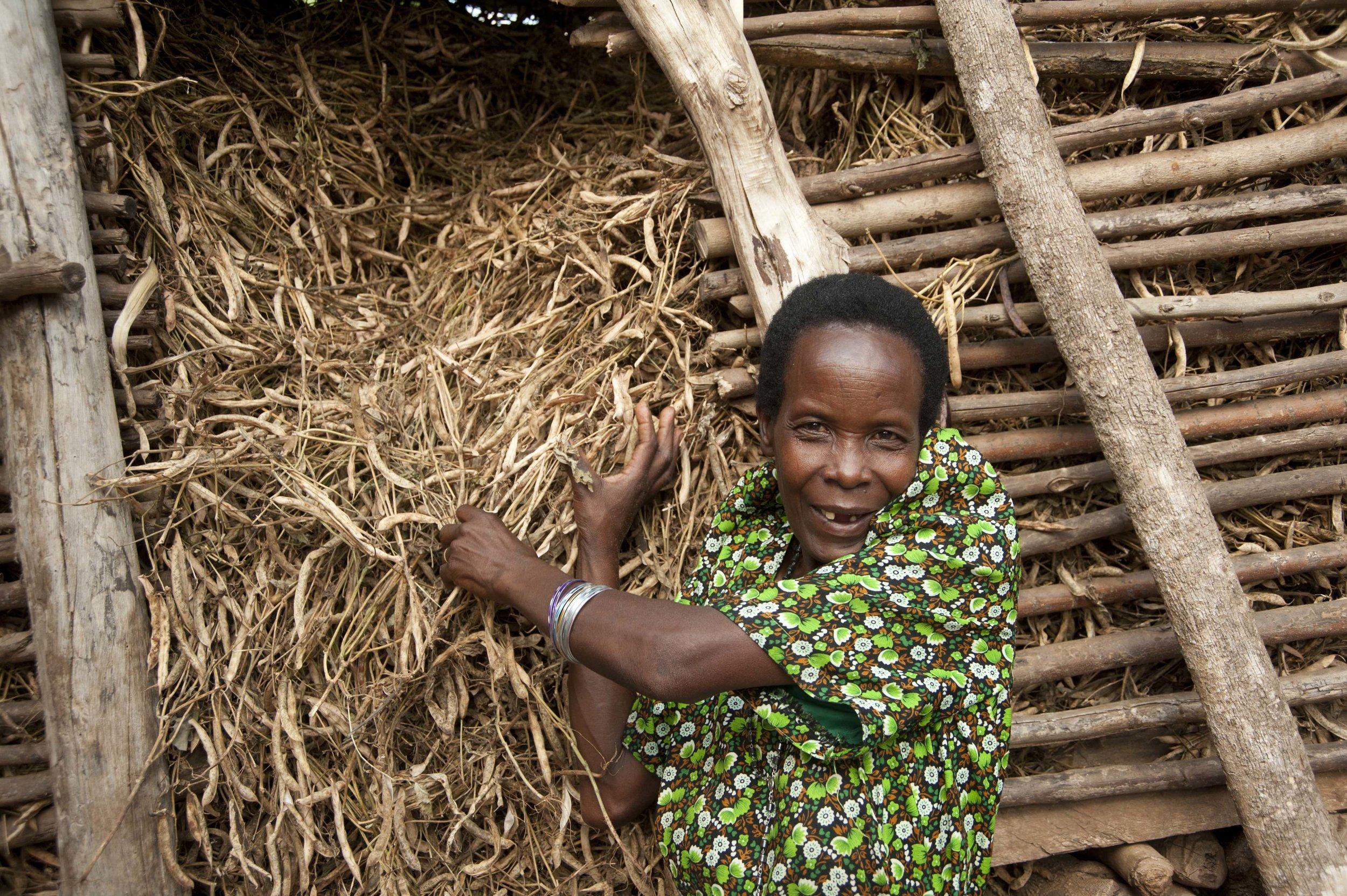 MY 1501 Uganda 2015-18 Great photo Akizanye at her storage with beans.jpg