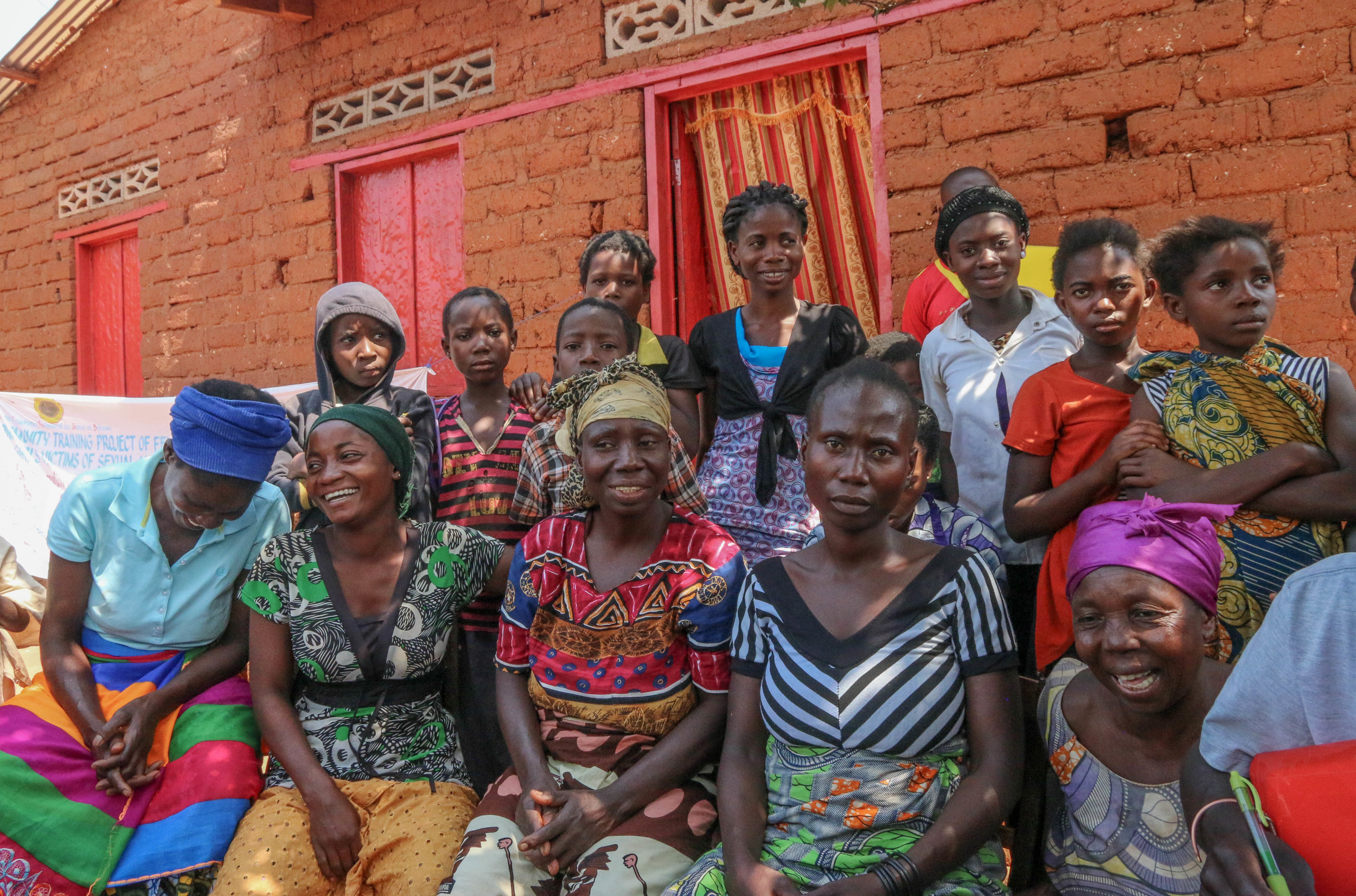 Site visit 16496 DRC women with beautiful red brick wall (1).jpg