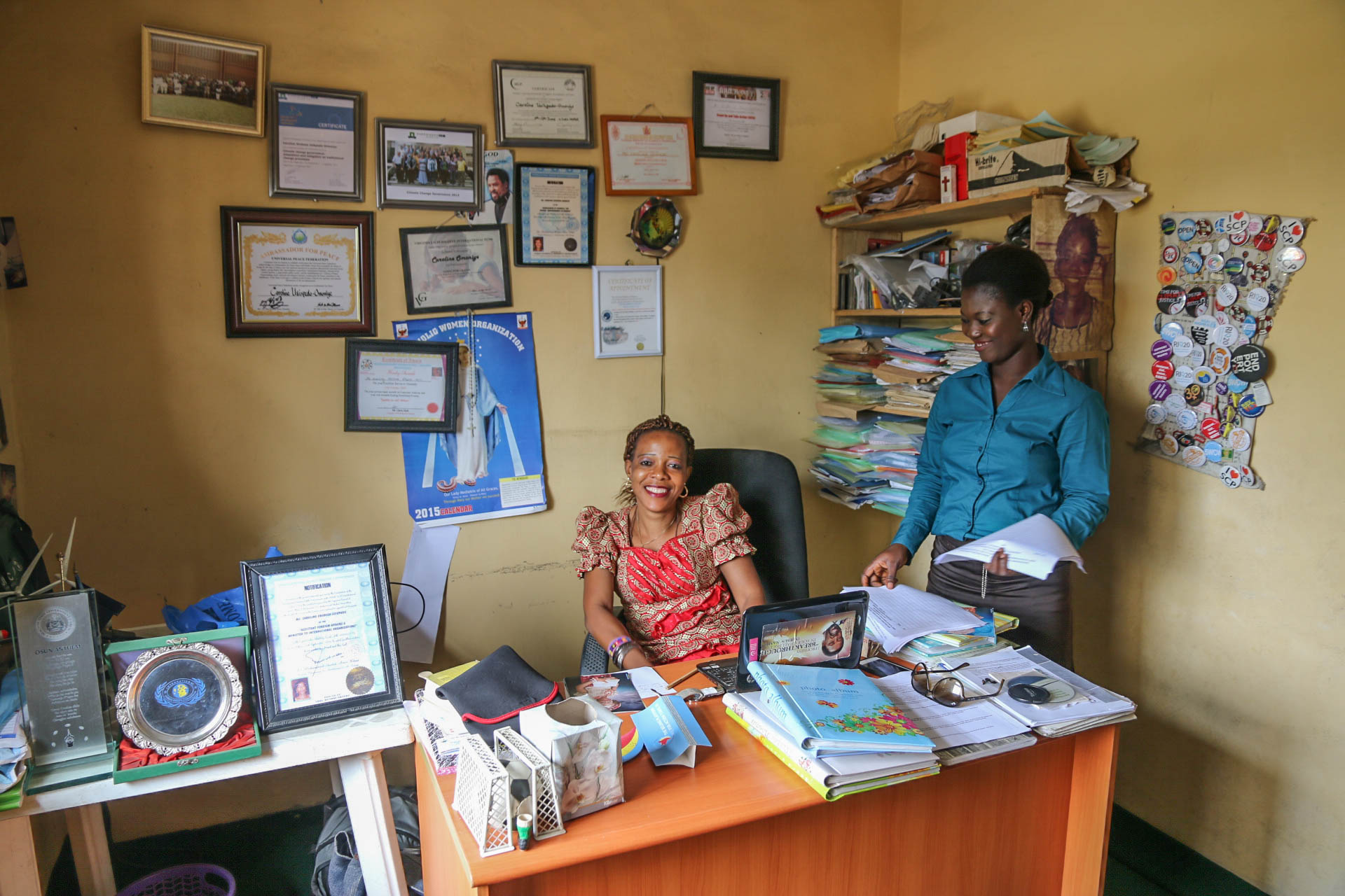 Site visit 12659 Nigeria Caroline at her desk with Roseline.jpg