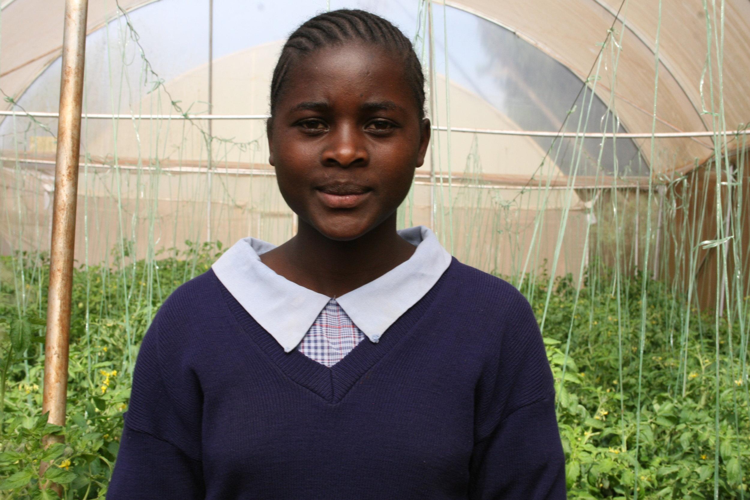 girl in a greenhouse 21699 Kenya (1).jpg