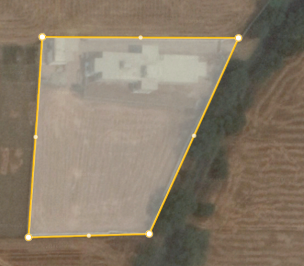 The compound to be planted with trees. The yellow lines are the extent of the perimeter wall. The plan is aligned with the compass directions, i.e. North is at the top of the plan, East is to the right of the plan, etc.