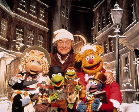 The Muppets' Christmas Carol, an adaptation of Charles Dickens's novel. A mean and miserly businessman called Scrooge is visited by the Ghosts of Christmas Past, Present, and Future. This is in order to warn him and change his ways to being more generous and kind hearted towards his workers and the rest he comes into contact with. He eventually heeds the message, and everyone lives happily ever after.