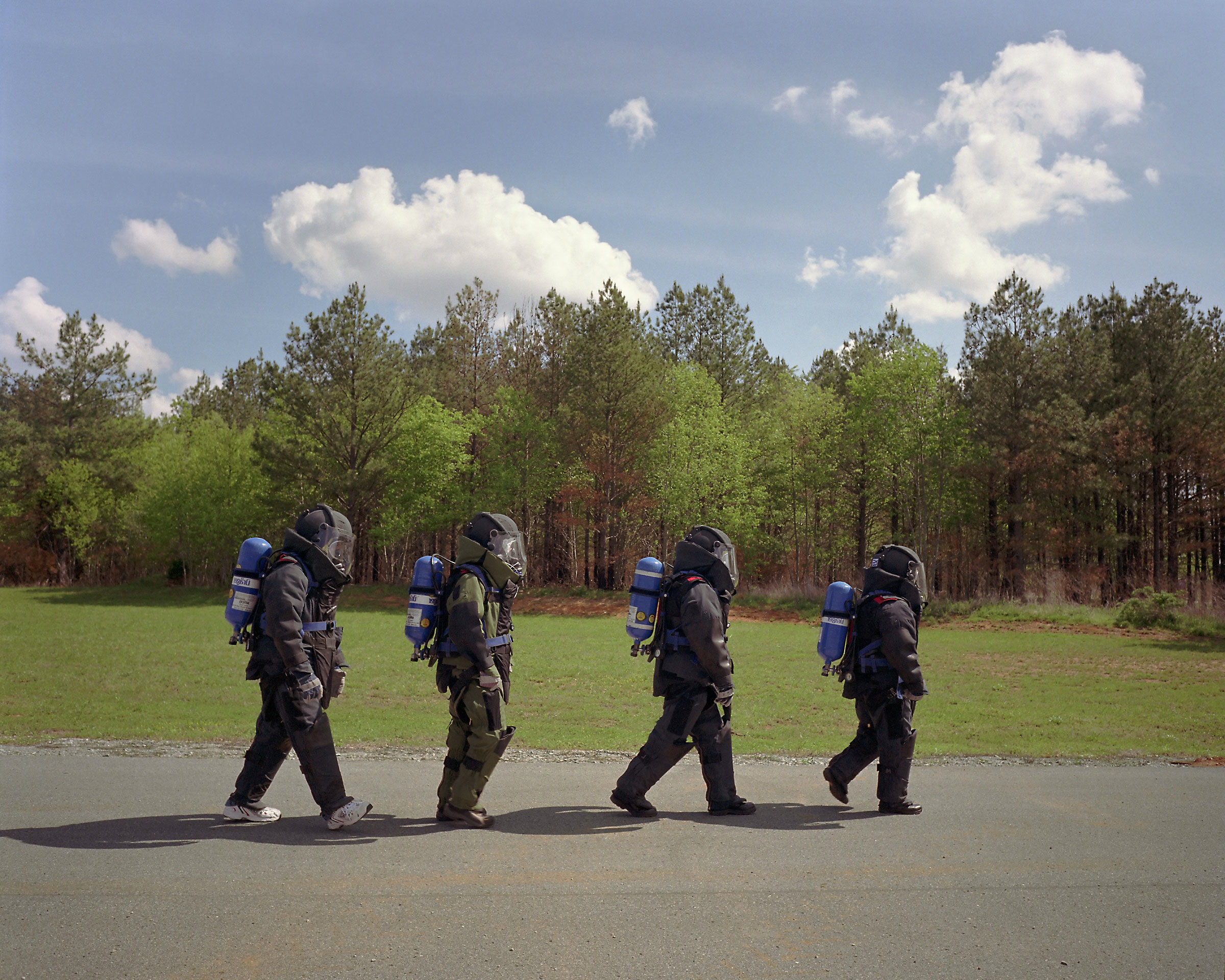 Bomb suits on road. (Hazardous Devices School, FBI and U.S. Army, Redstone Arsenal, Huntsville, AL) 2007.