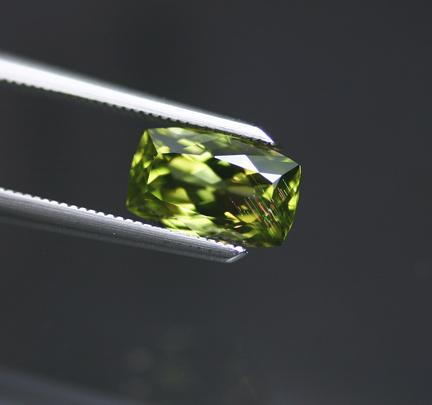 0.97 ct. Pallasite Peridot with Iridescent Needles