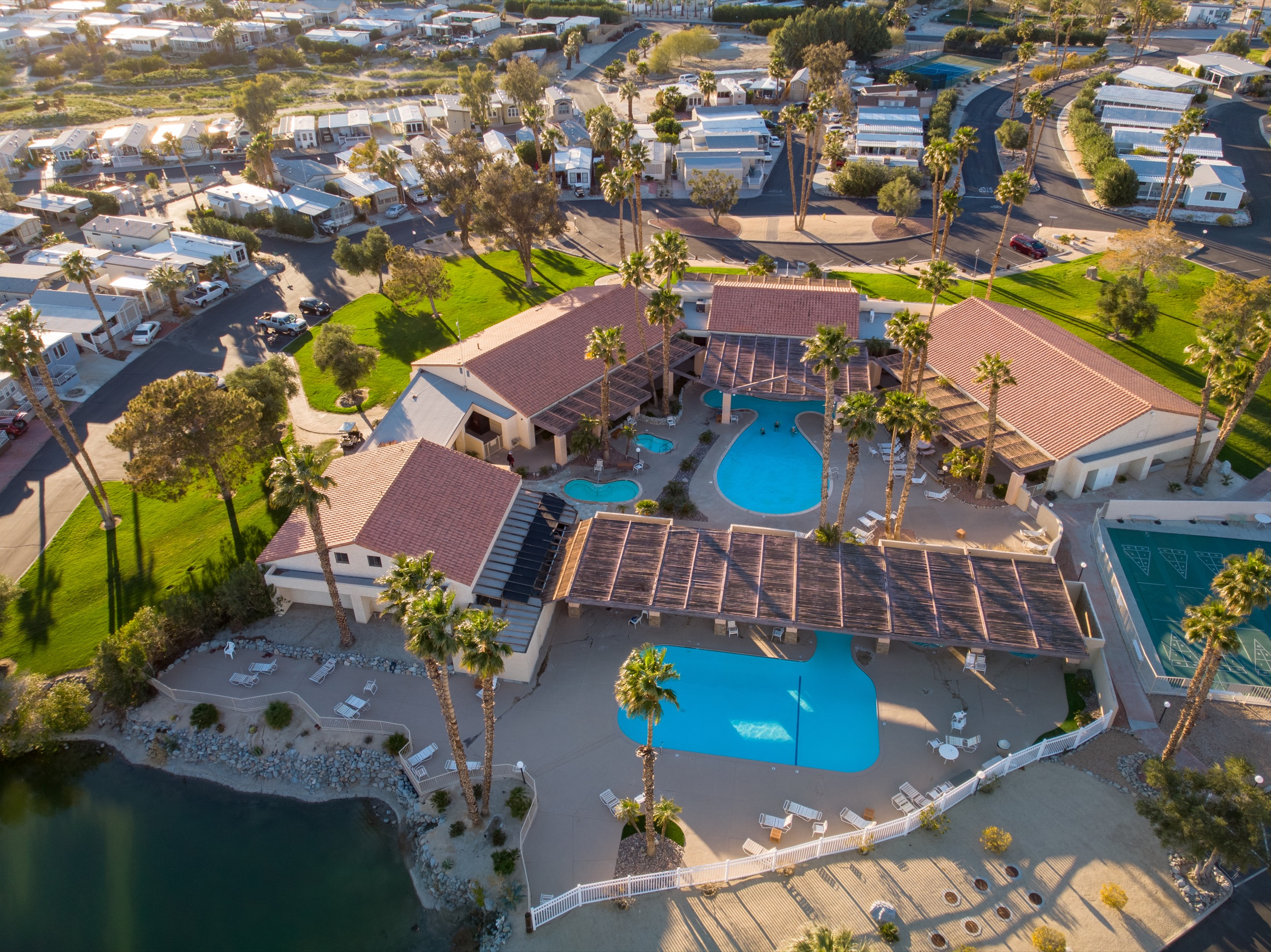 RESORT AMENITIES - HOT MINERAL POOLS AND SPASTWO CLUBHOUSE LOCATIONSSTATE-OF-THE-ART PICKLEBALL FACILITYFITNESS AND CARDIO ROOMSDOG PARKSTENNIS COURTSWALKING TRAILSHORSESHOES AND BOCCEGAME ROOMON SITE RESTAURANT