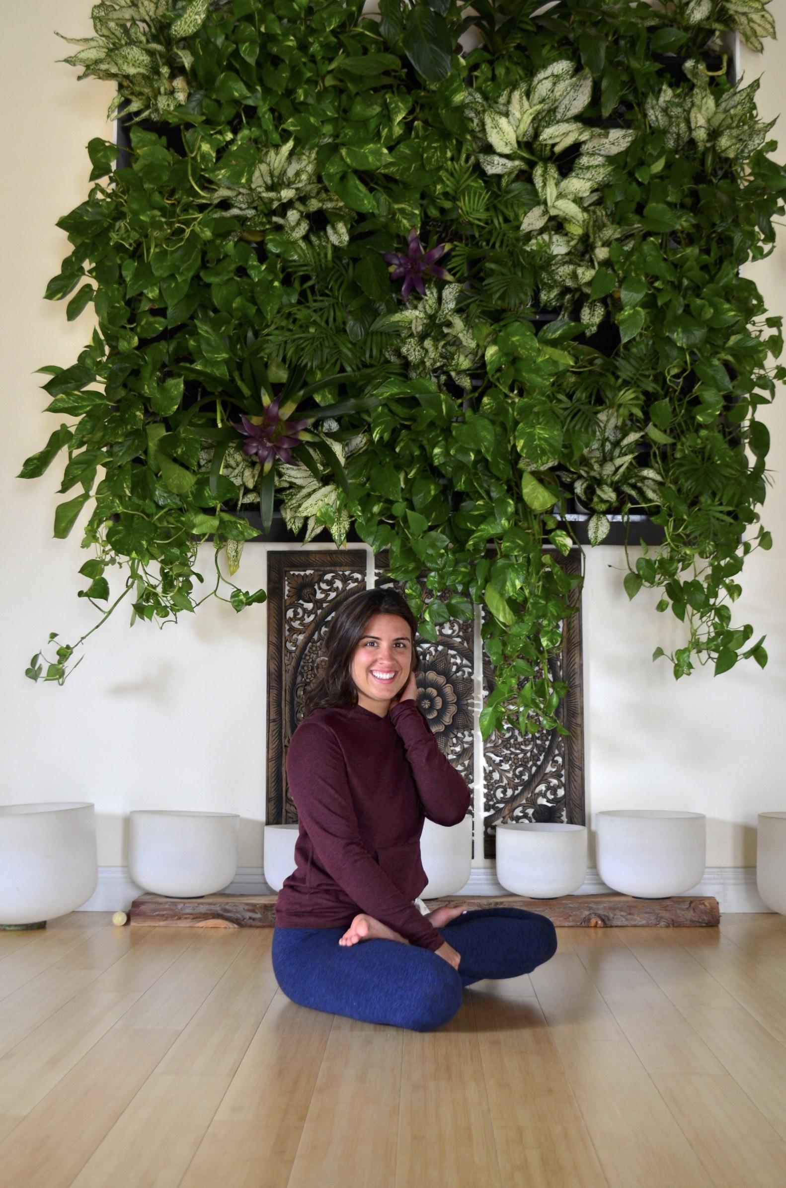 Lotus pose & pothos plants.