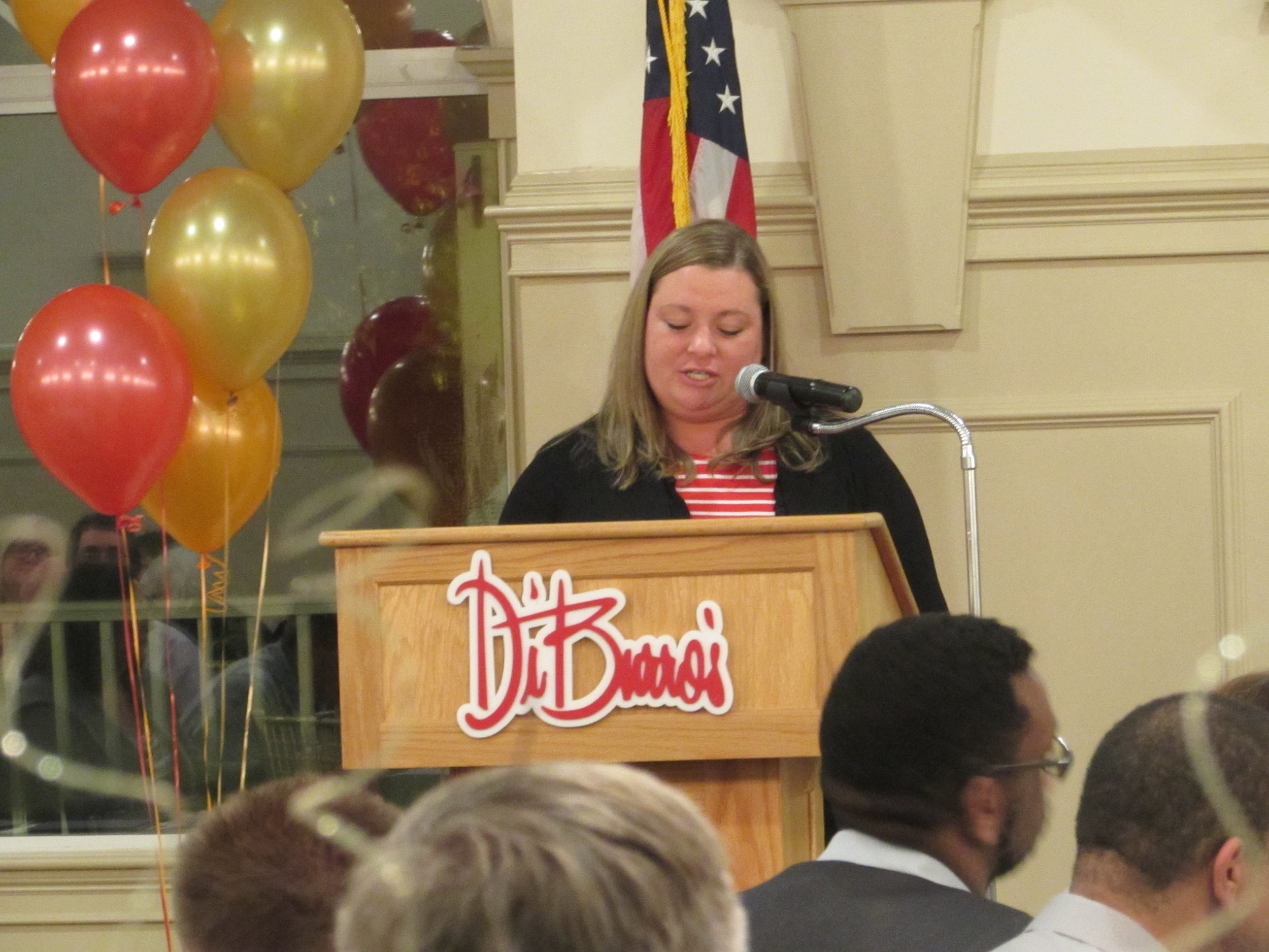 Lindsay Mewa speaking about expeirence with program at annual event.jpg