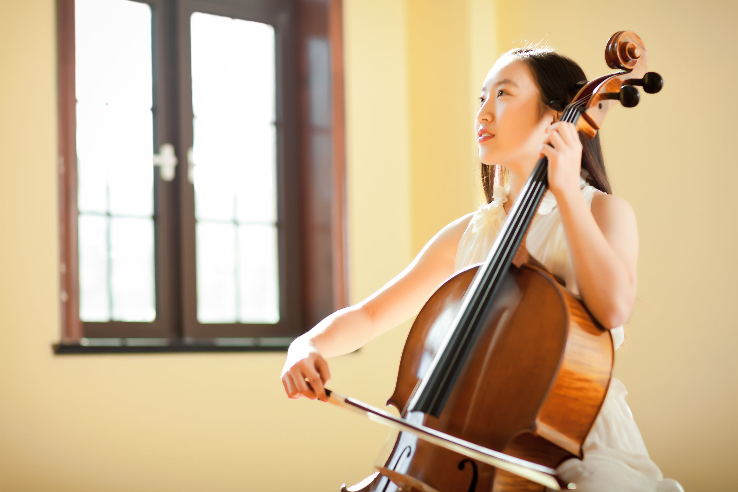 cms istock asian girl playing cello.jpg
