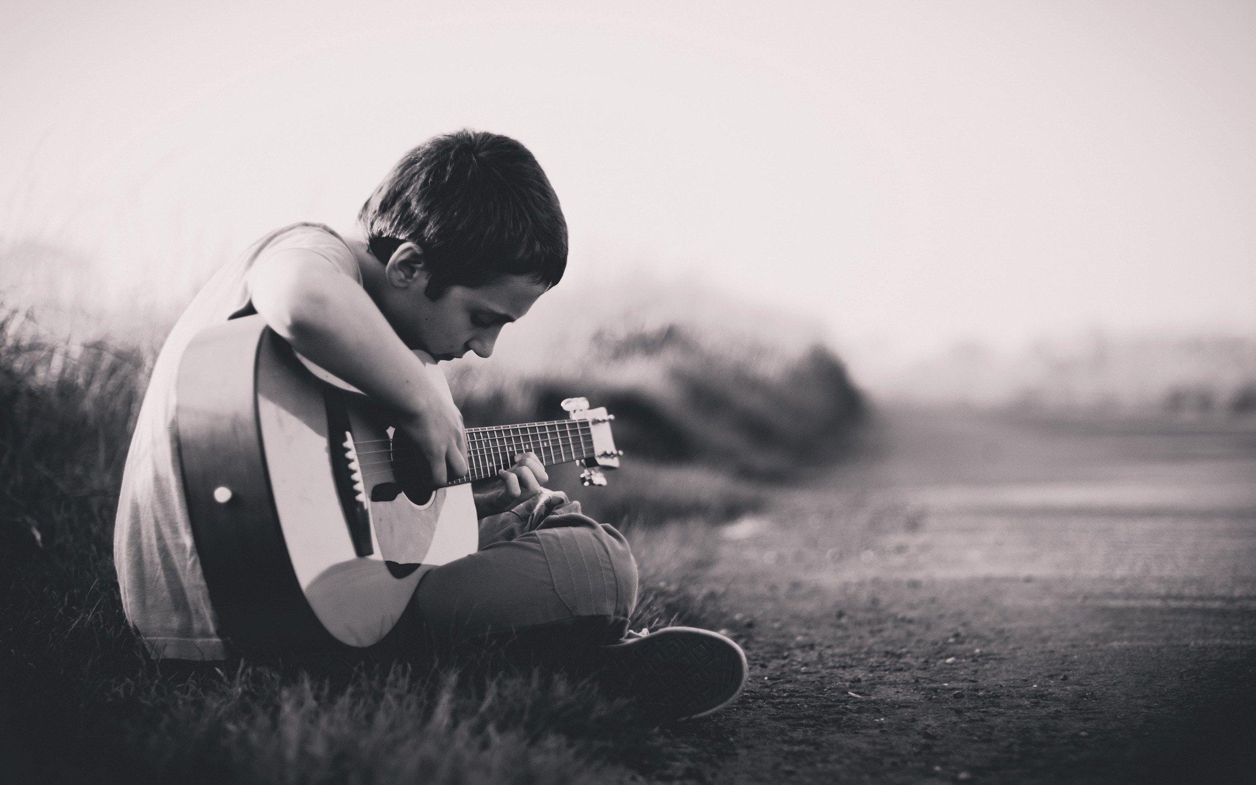 cms unsplash teen with guitar.jpeg