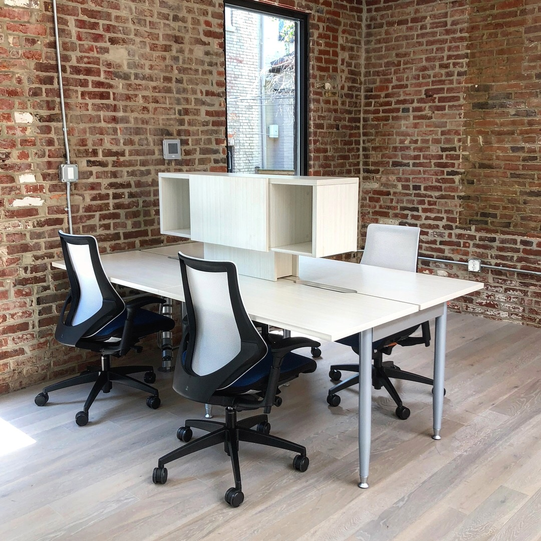 Clean and Open Communal Office Workspace.JPG