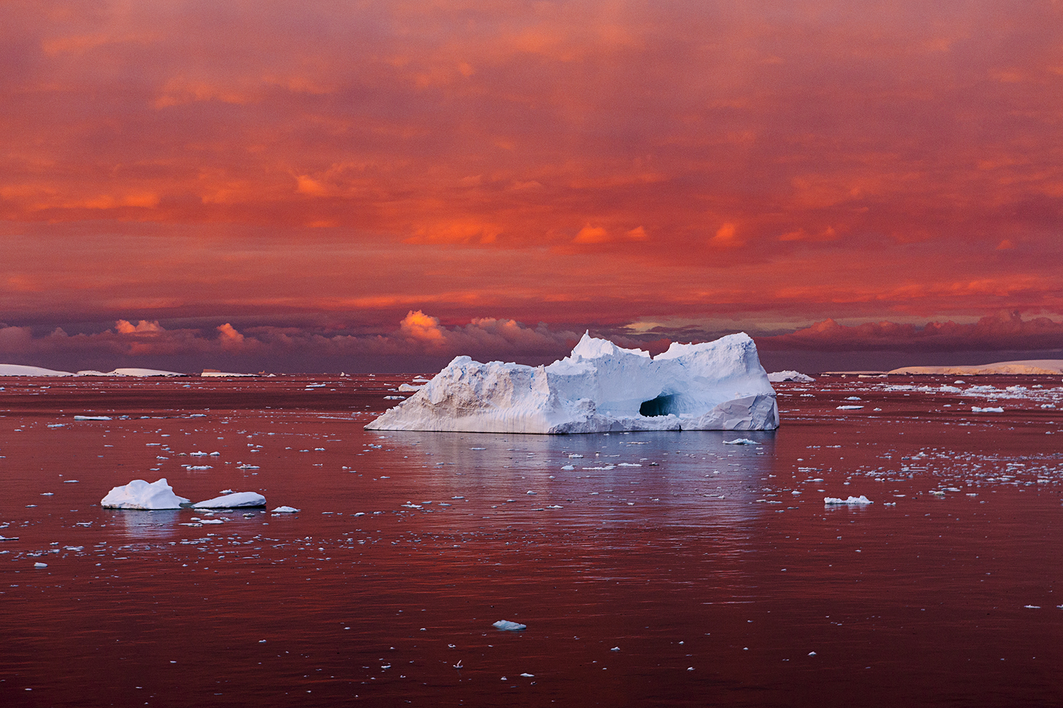 Iceberg in Blood Red Sea, Lemaire Channel, Antarctica - The Lemaire Sunset