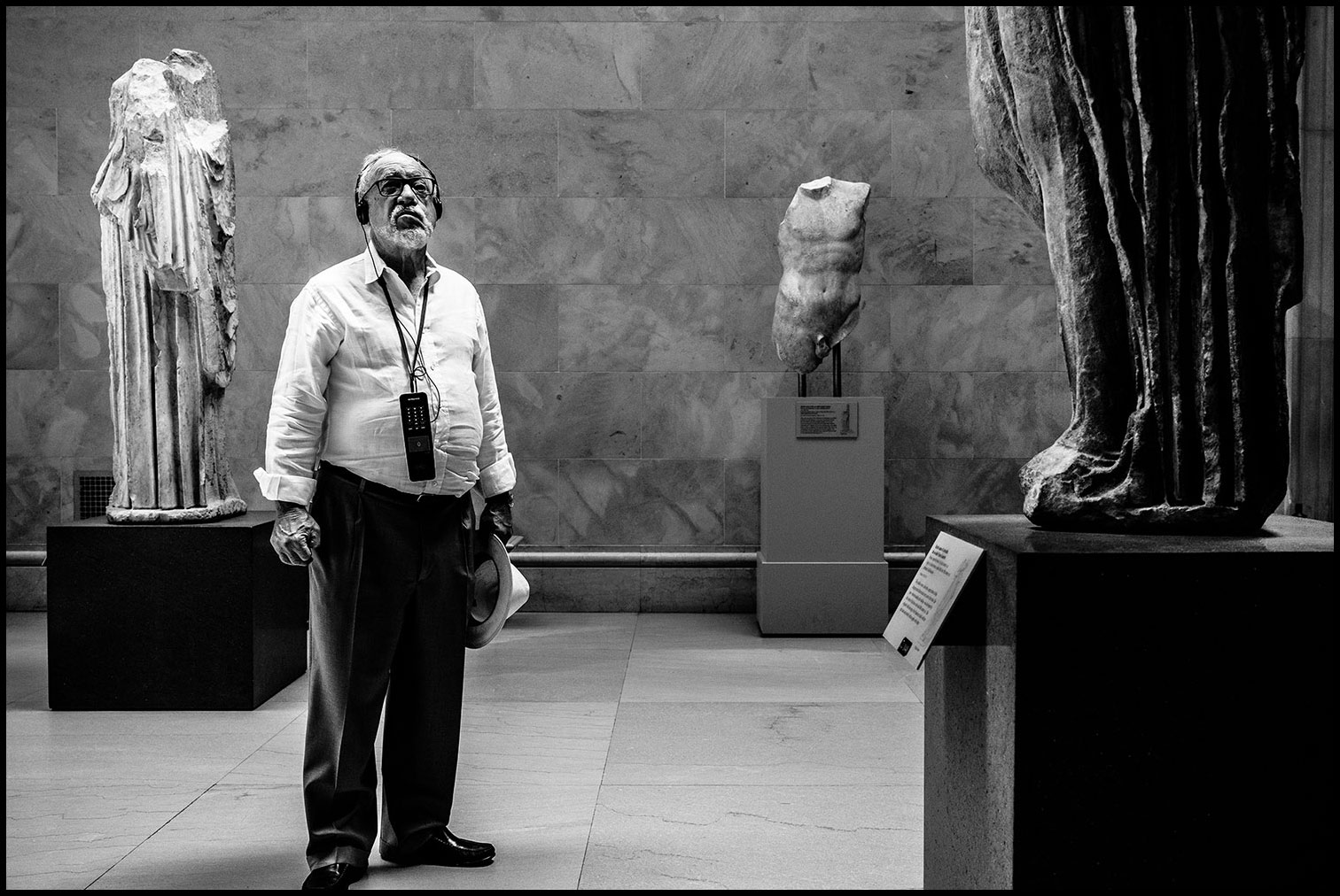 The Art Critic  (New York, NY) 2017 // A patron at the Metropolitan Museum of Art gazes at Greco-Roman statues while listening to the audio tour.