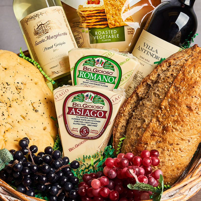 Gift basket featuring artisanal breads and European cheeses, designed by staff at Bayside Fresh Market.