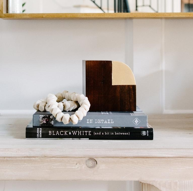 White Hex Bone Beads from McGee and Co. Beads are a perfect way to add visual interest to any shelf or coffee table. Make sure your living room isn't falling flat
