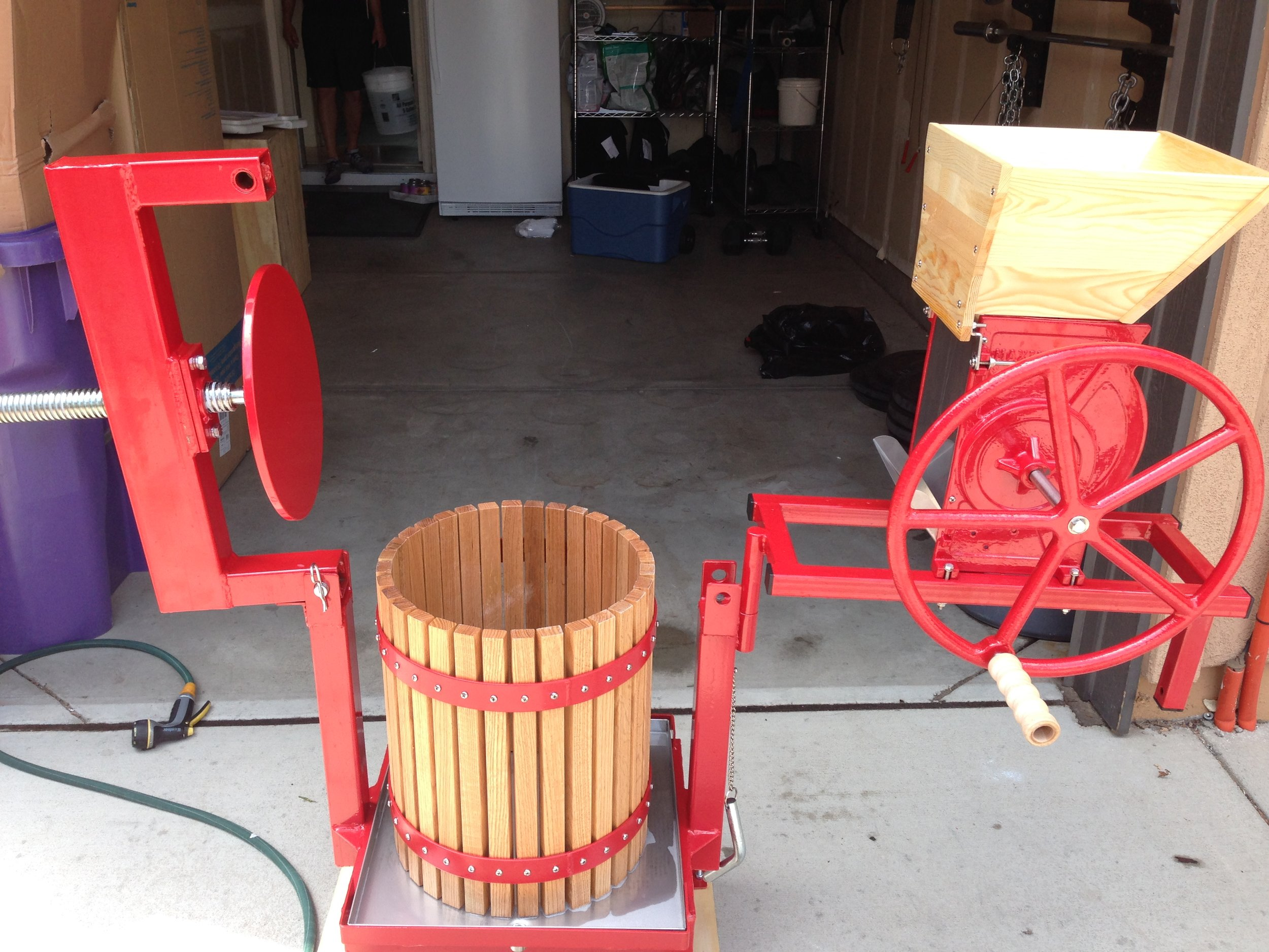 Our first cider press... in our townhouse garage!