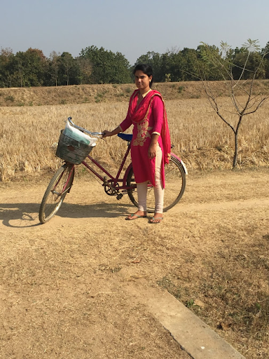 This is one of the girl's teachers who also rides her bicycle to school each day as well.