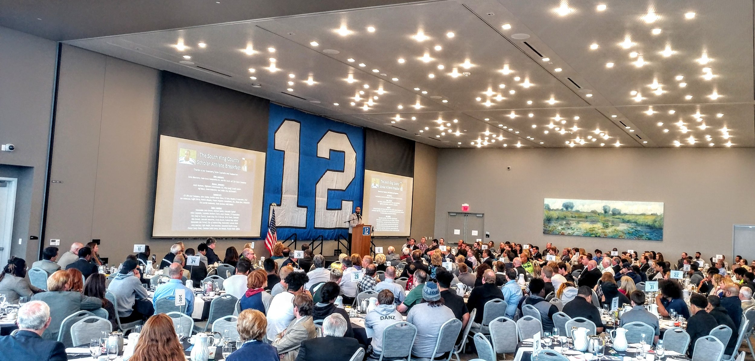Seattle Seahawks Wide Receiver Doug Baldwin speaks to more than 250 supporters at the 2018 South King County Scholar Athlete Breakfast.