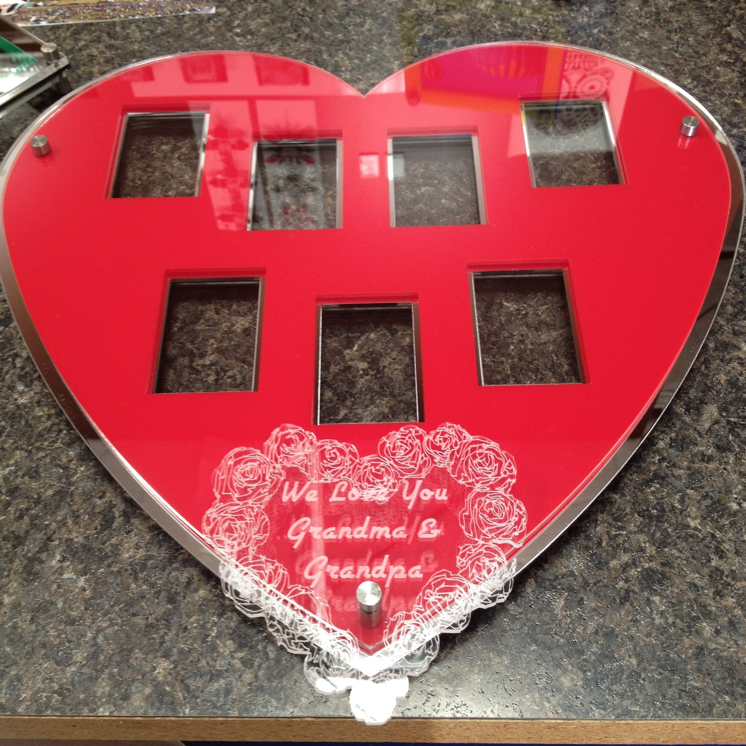 Heart-shaped Valentine's Day frame holds 7-wallet sized photos and personal message below.  Contact us for pricing information.