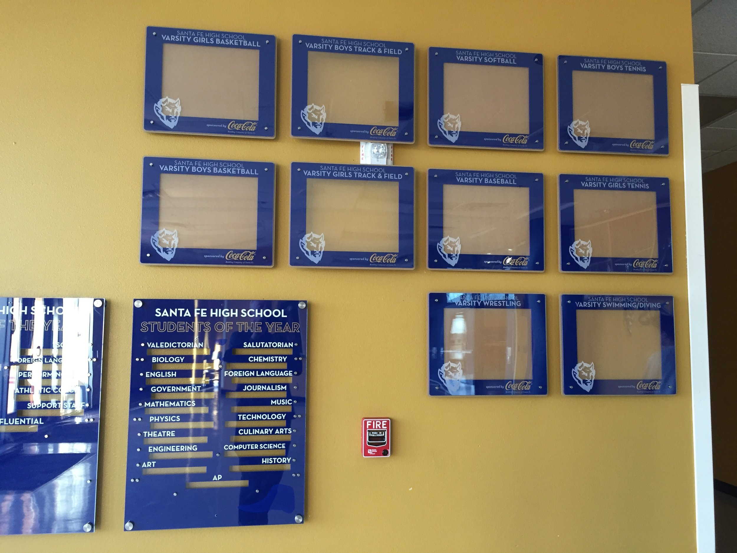 High School Gym 11x14 multi-frame installation w/leader boards  Example of one of our public installations.