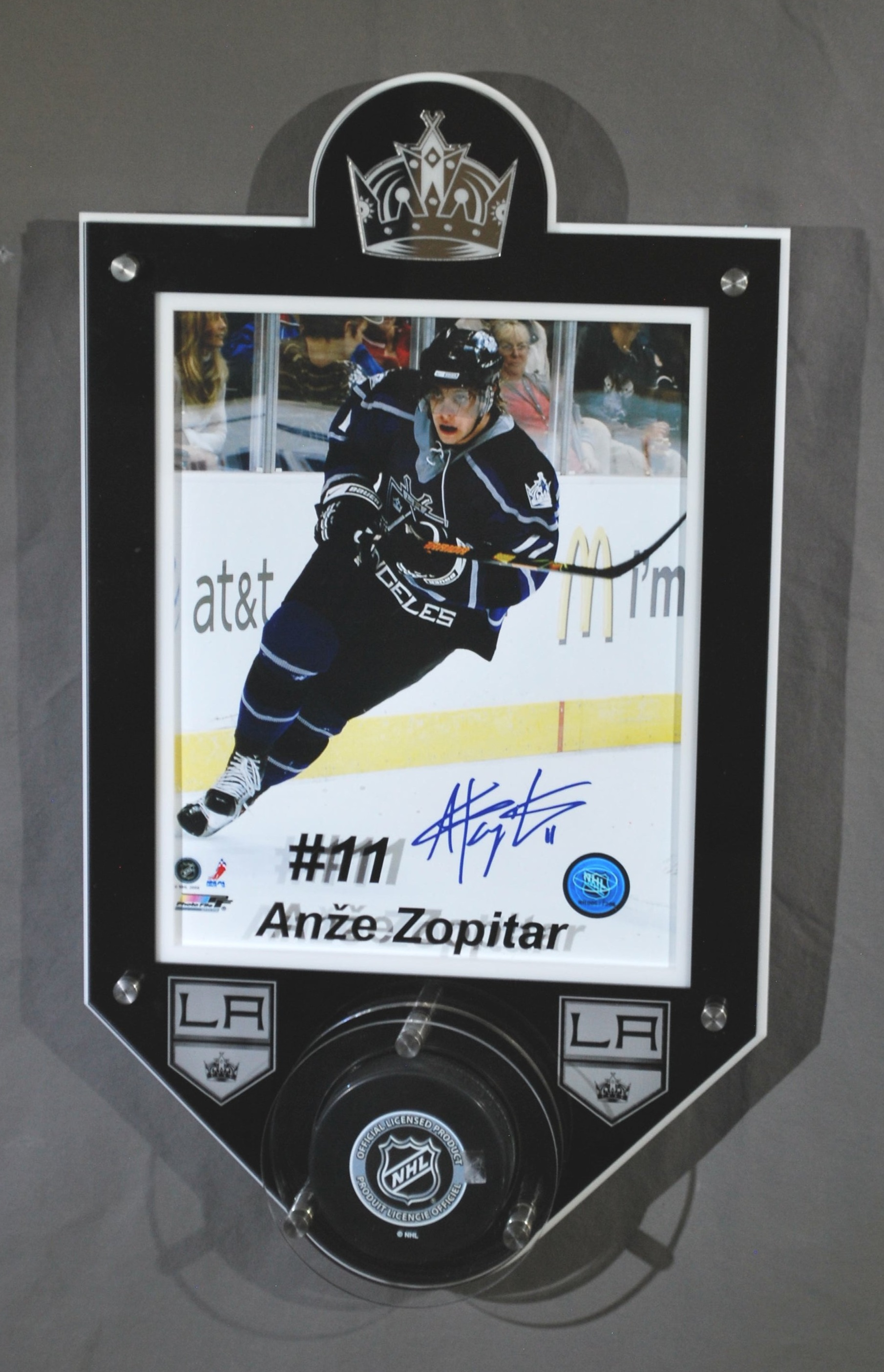 8x10 portrait frame holds hockey puck - 5-layer acrylic, in team colors, Inlay logo, color enhanced player name and number.  Contact us for pricing information.