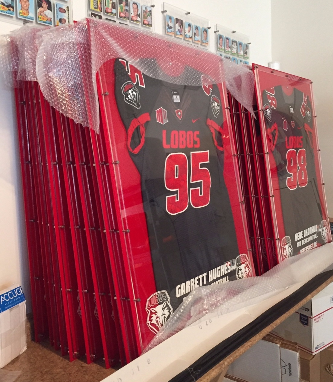 Multi-Jersey Press order for the University of New Mexico Lobo Football Team - Etched with player name, hometown, years in the program and Lobo Seal.  Contact us for pricing information.
