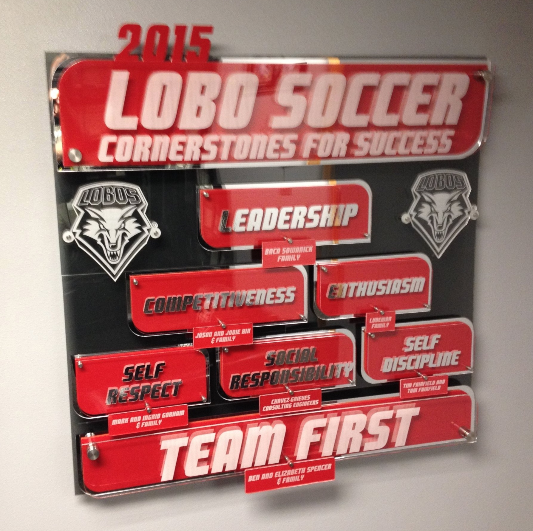 """Custom Display - 40""""x 40""""x 3.5"""", multi-layer acrylic display of University of New Mexico Men's Soccer """"Pyramid of Success"""".  Replaceable tags document annual Program Sponsors.  Contact us for pricing information."""