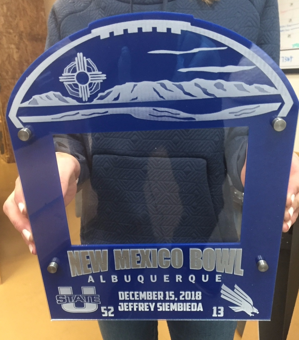 5x7 landscape New Mexico Bowl photo frame - 4-layer acrylic, event/team colors, upper half custom fabricated and etched to resemble football  Contact us for pricing information.