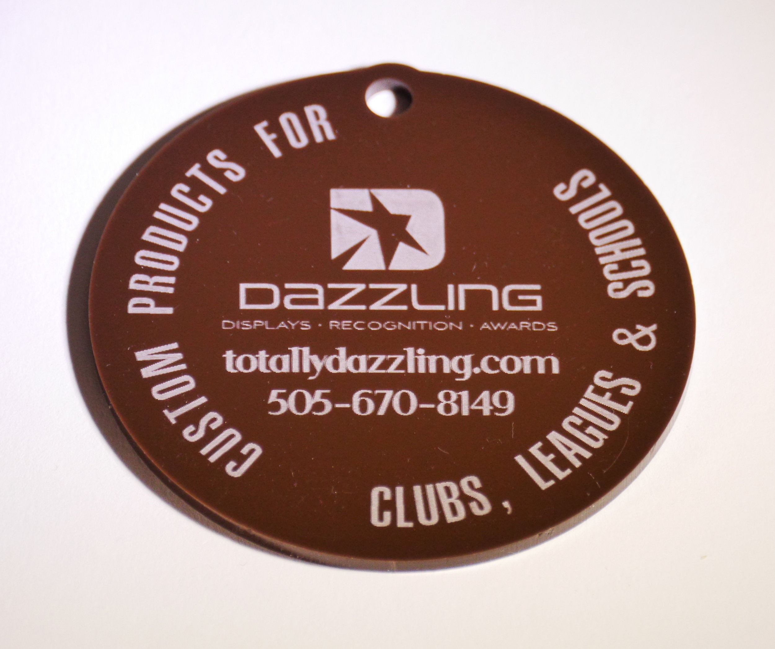 "3.5""D Custom Medallion - Custom etching in very fine tolerance.  Graphic software to quickly manipulate text and imagery.  A long history with custom fabrication, promotional products, and branding guidelines.  Contact us for design and pricing information."