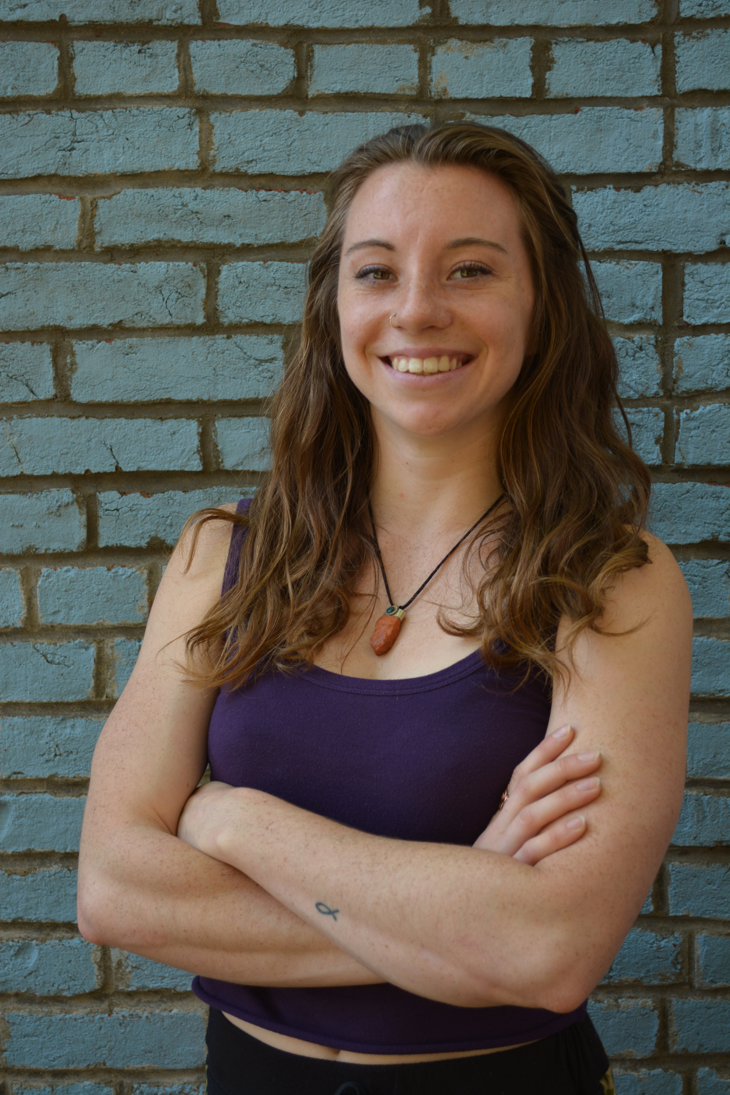 Lauren English, 200 RYT - Lauren was introduced to yoga in 2010 through P90X home fitness videos, seeking to achieve beautiful postures and complete difficult workouts. Later, yoga classes at school brought her to her mat again. She came to the mat stressed, anxious, and eager to please everyone around her.Over the years, Lauren was transformed mentally and spiritually; Yoga brought her focus and peace. She learned mindfulness, meditation, and the importance of breath. Through yoga, she unleashed her inner power, peace, and focus.Lauren enjoys CrossFit, mountain biking, rock climbing, traveling, trying new food, learning new languages, and doing anything outside. She coaches at CrossFit Old School in Bowling Green, Kentucky. With a CrossFit Level one and CrossFit Gymnastics Certifications, she aspires to achieve her Level 2 certification soon. She has a Bachelor of Arts degree in Diversity and Community Studies from Western Kentucky University.When students take her class, students embark on a journey of self-discovery. With a challenging Power Vinyasa flow, students move in their own bodies with curiosity, humor, and peace. Lauren aims to promote ideas of respect, radical love, and generosity towards our bodies, our neighbors, and the earth. Her teaching style of Power Vinyasa yoga can be describes as rigorous, energizing, breath focused, cheerful, and introspective.