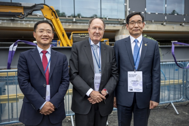 At the Bio-Innovation Centre topping-out ceremony on the Science Park are, from left, Jiwu Wang, chairman of Tus-Holdings, master of Trinity College Sir Gregory Winter and Yuxian Zhou, CEO and Board Member of CNIC Corporation Limited. Picture: Keith Heppell