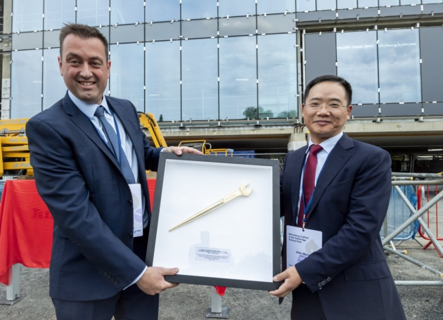 From left, Adam Knaggs Director, of SDC, presents Jiwu Wang, chairman of Tus-Holdings, with a commermorative spanner. Picture: Keith Heppell