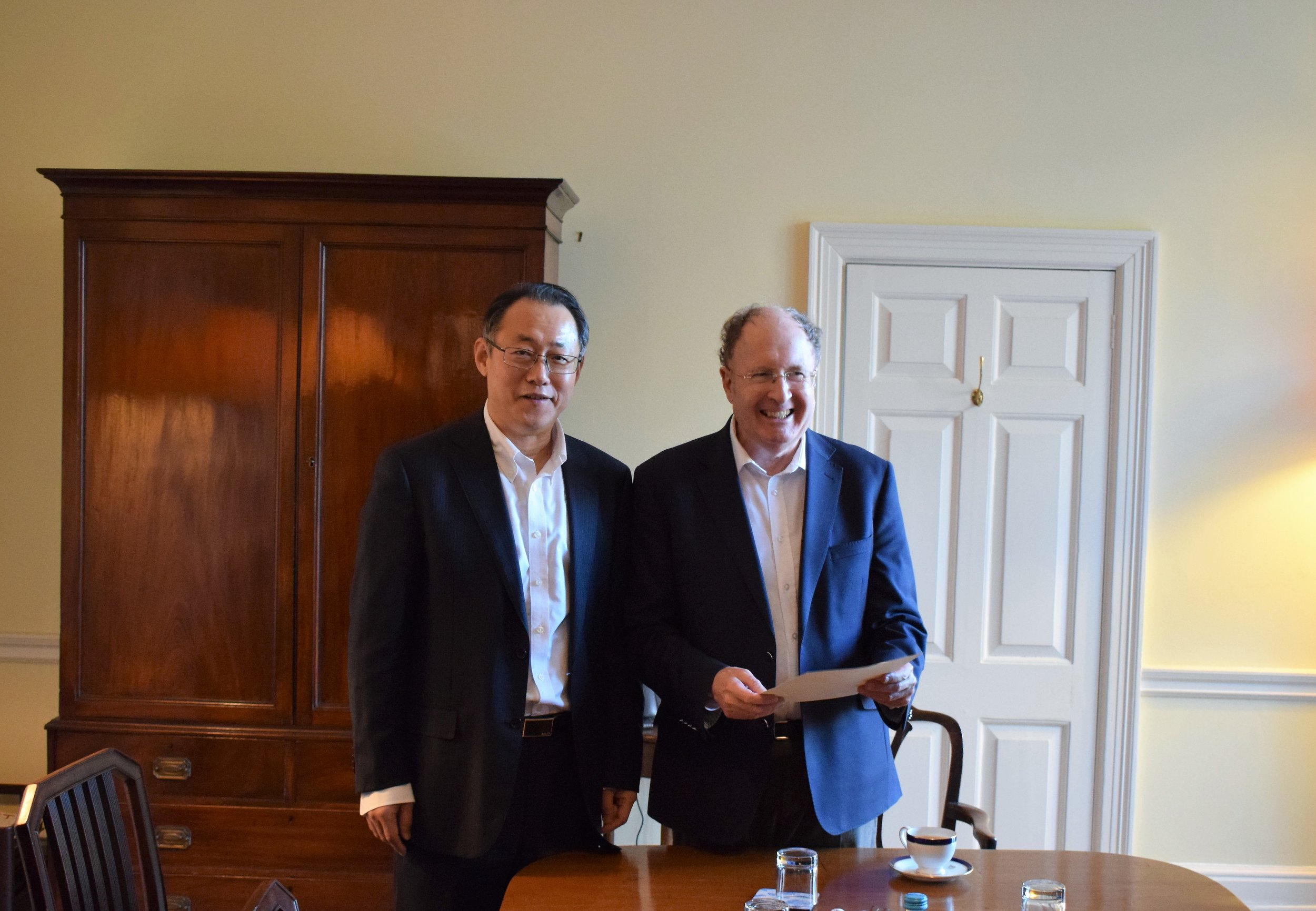 Sir Grey Winter (right) received congratulate letter from Yubo Zhou (left), Chairman of CNIC