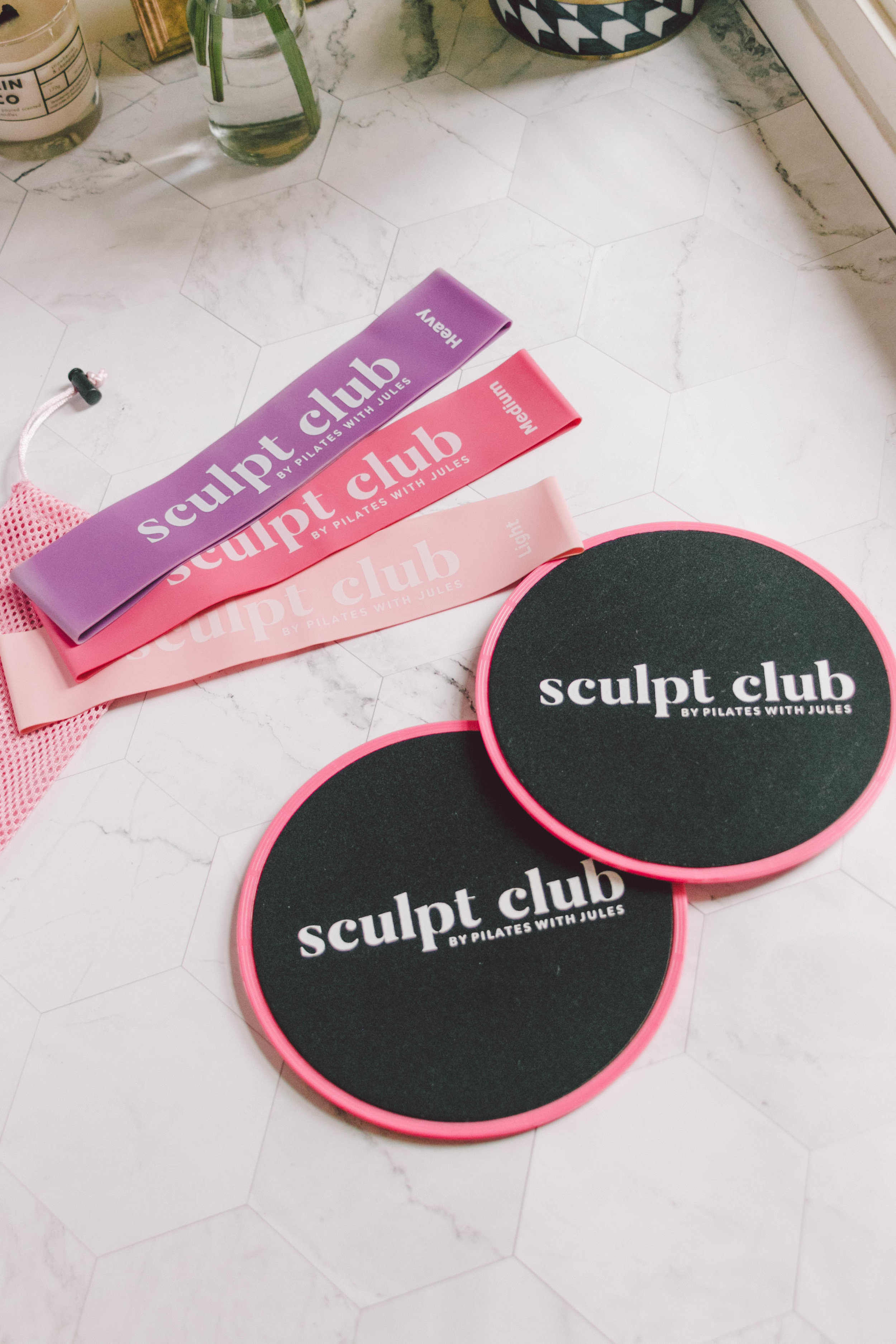 Sculpt Club Travel Kit - As much as I love reformer pilates, it's definitely not the most accessible way to workout, especially if you're travelling or want to workout from home. The Sculpt Club Travel Kit by Pilates with Jules comes in a cute tote bag with a set of sliders and resistant bands (in 3 levels of resistance). It makes doing the same low impact, strengthening and lengthening exercises on the go so much easier.I've been challenging myself by incorporating the sliders and resistant bands into my workouts to work my core and other areas of weakness more.