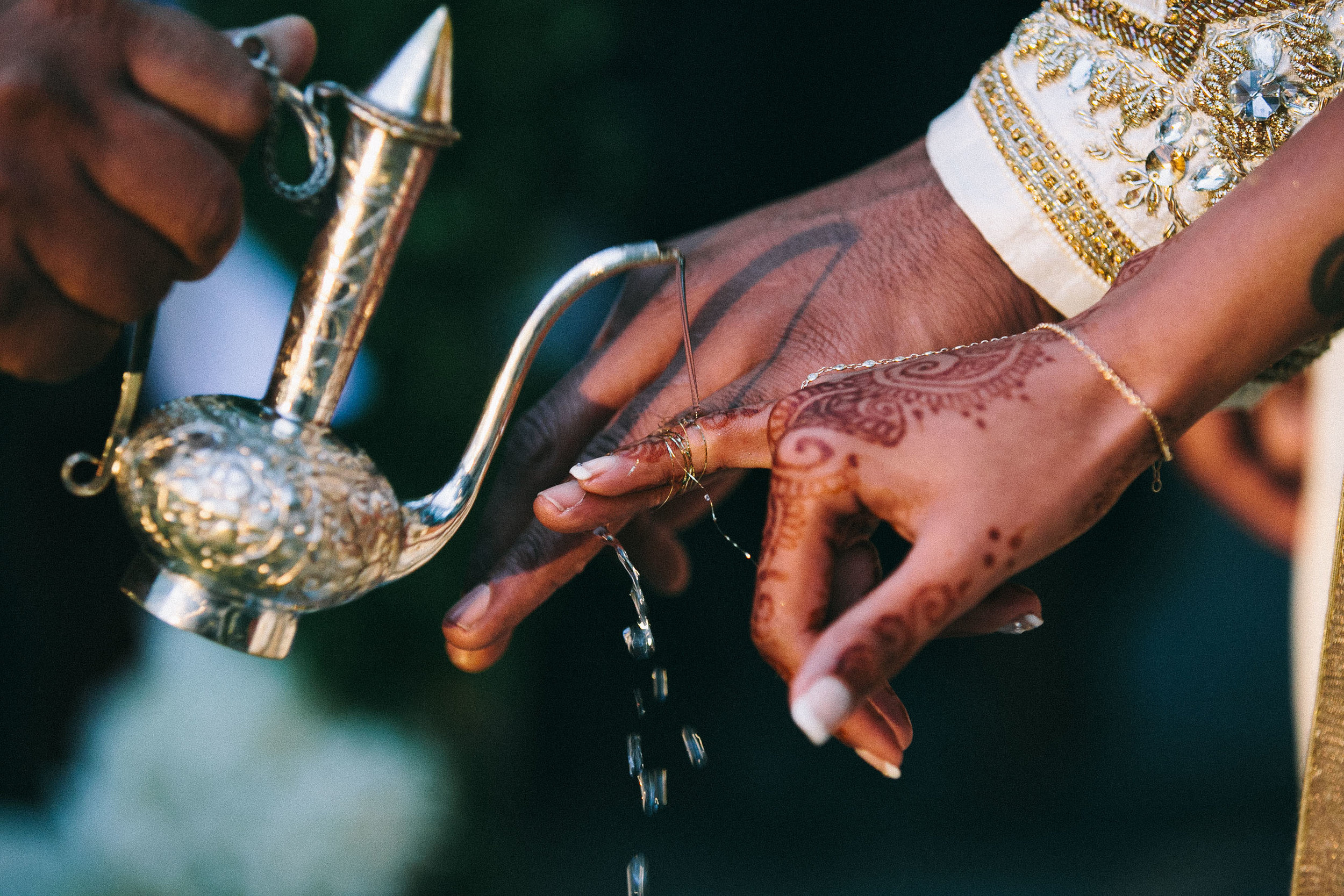 Sri Lankan wedding ceremony Los Angeles fingers tied water poured over