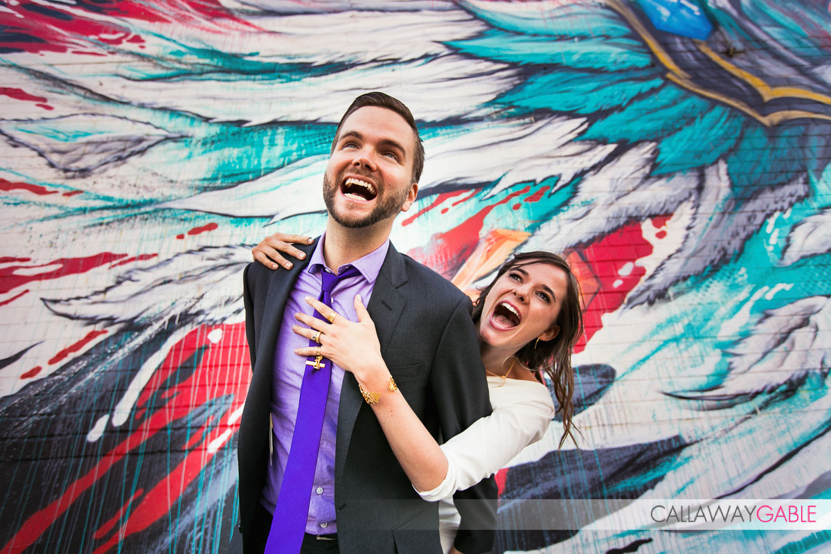 hilarious engagement photo in front of street art wall in downtown Los Angeles