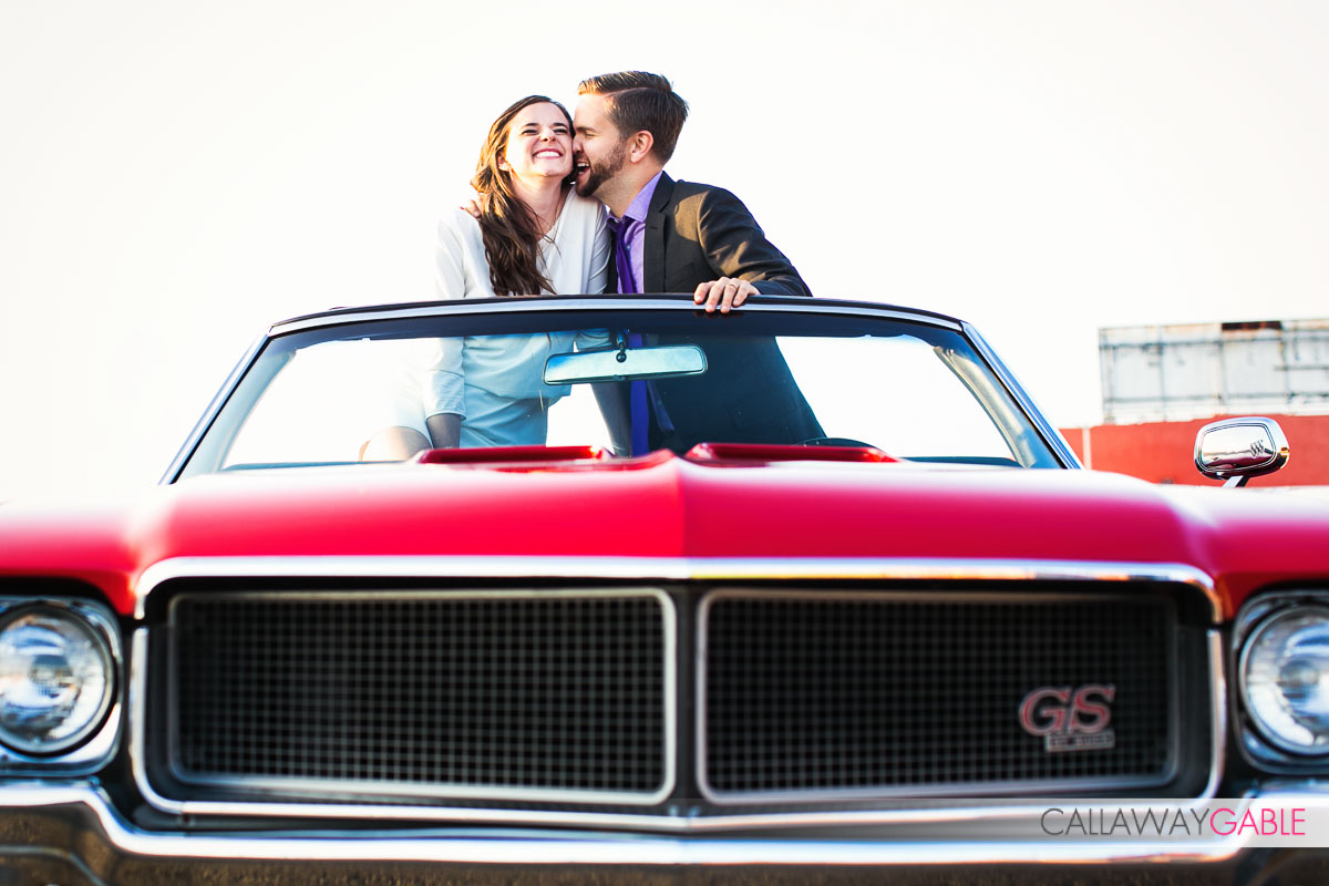 Downtown Los Angeles Engagement Photo with red car and a dog